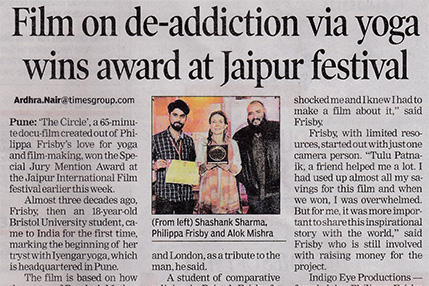 A newspaper extract titled 'Film on de-addiction via yoga wins award at Jaipur festival'