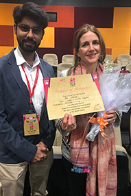 Philippa Frisby and Shashank Sharma holding certificates and flowers